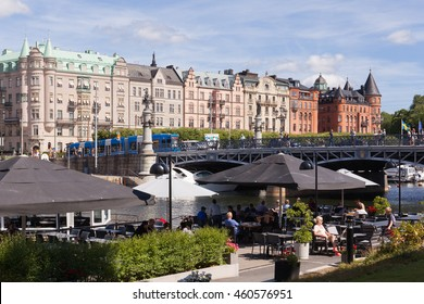 Stockholm, Sweden - Jul 27, 2016 : View of Stockholm djurgarden bridge, waterfront park and cafe in summer.