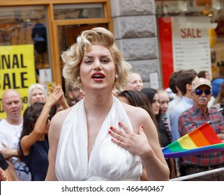 STOCKHOLM, SWEDEN - JUL 30, 2016: Transvestite man dressed as Marilyn Monroe wearing a white dress in the Pride parade July 30, 2016 in Stockholm, Sweden