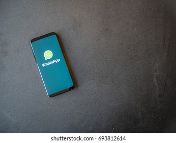 STOCKHOLM, SWEDEN - JULY 10, 2017:  WhatsApp application on screen of a smartphone. Dark background.
