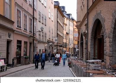 STOCKHOLM, SWEDEN - JULY 11, 2012: Tourists walk through the streets of the old city in Stockholm, Sweden
