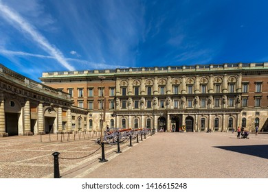 STOCKHOLM, SWEDEN - JULY 11, 2014: Front view of the Royal Castle outer courtyard with blue sky, cannons and incidental people in the background in Stockholm Sweden July 11, 2014.