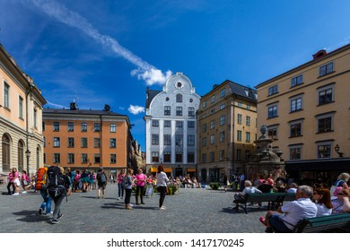 STOCKHOLM, SWEDEN - JULY 11, 2014: Wide view of people on the square Stortorget in the Old Town with surrounding medieval buildings in Stockholm Sweden July 11, 2014.
