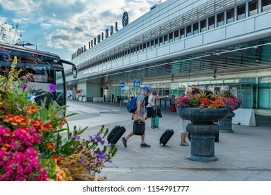 STOCKHOLM, SWEDEN - JULY 12, 2018 : A group of passengers are walking to the departure hall of Arlanda International Airport terminal