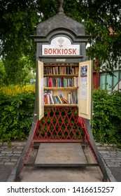 STOCKHOLM, SWEDEN - JULY 16, 2014: Outdoor front view of a steel vintage traditional phone booth made into a small public library in Stockholm Sweden July 16, 2014.