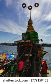 Stockholm, Sweden July 18, 2020 Trash pulled up from the bottom of Lake Malaren and displayed on a barge, a community project called Rena Malaren, and a tower of tires made to look like City Hall.