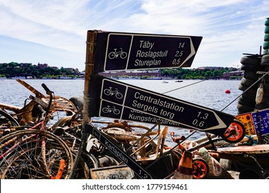 Stockholm, Sweden July 18, 2020 Trash pulled up from the bottom of Lake Malaren and displayed on a barge, a community project called Rena Malaren.