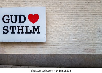 STOCKHOLM, SWEDEN - JULY 19, 2014: Exterior front view of a steel sign with text God Loves Stockholm on a brick wall outdoors in Stockholm Sweden July 19, 2014.