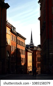 Stockholm, Sweden - July 2014: Light and shadow reflects on historic buildings in Gamla Stan, the old town of Stockholm, Sweden