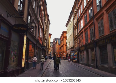Stockholm, Sweden - July 2014: Tourists walking on the old cobble streets in the market in Gamla Stan, the old town of Stockholm in Sweden