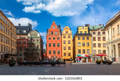 Stockholm, Sweden - July, 2018: Colorful facade of the houses in Stortorget Square Gamla Stan. Stockholm, Sweden with tourists at summer sunny day.