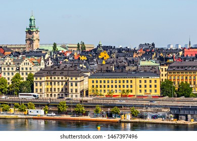 STOCKHOLM, SWEDEN - July 2019: Stockholm cityscape view from the Monteliusvägen view point, Stockholm downtown, Sweden. Storkyrkan clock tower in Stockholm cityscape, Sweden