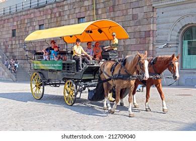 STOCKHOLM, SWEDEN - JULY 30, 2014: Stockholm carriage tour