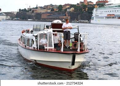 STOCKHOLM, SWEDEN - JULY 30, 2014: Hop on hop off boat docking in Stockholm