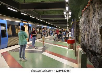 STOCKHOLM, SWEDEN - JULY 9, 2018: Passengers at Kungstradgarden, station of Stockholm metro