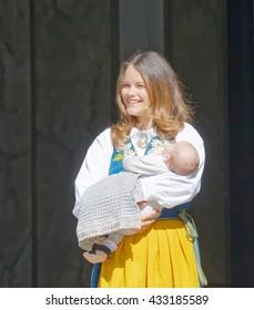 STOCKHOLM, SWEDEN - JUN 06, 2016: The smiling swedish princess Sofia Hellqvist holding her baby Alexander