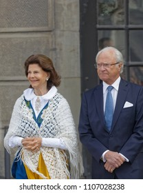 STOCKHOLM, SWEDEN - JUN 06, 2018: The swedish queen and king Silvia and Carl Gustaf Bernadotte XVI outside the castle to celebrate the swedish national day June 06 in Stockholm