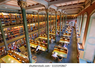STOCKHOLM, SWEDEN - JUN 14, 2018: Great book collections and reading people inside the National Library of Sweden on June 14, 2018. Library established in 1661 consist 18 million books and manuscripts