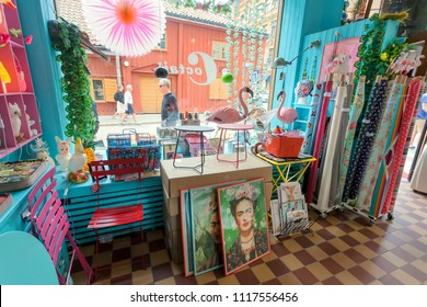 STOCKHOLM, SWEDEN - JUN 14, 2018: Posters Frida Kahlo in boho style interior of store with funny decoration elements on June 14, 2018. Sweden with 10,5 million people ranks high in life expectancy