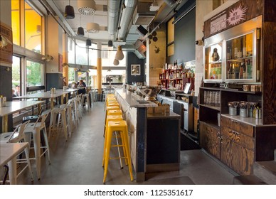 STOCKHOLM, SWEDEN - JUN 15, 2018: Interior of the modern cafe with bar counter and many bottles with alcohol on June 15, 2018. Sweden with 10,5 million peope ranks high in life expectancy
