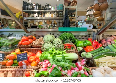 STOCKHOLM, SWEDEN - JUN 16, 2018: Tomatoes, celery, cabbage and other organic vegetables, oils on counter of food market on June 16, 2018. Sweden with 10,5 million peope ranks high in life expectancy