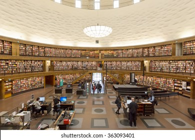Stockholm, Sweden - Jun 2, 2015 : The inner view of Stockholm Public Library. At this main hall, people are borrowing, returning books and searching information with librarian at the help desk