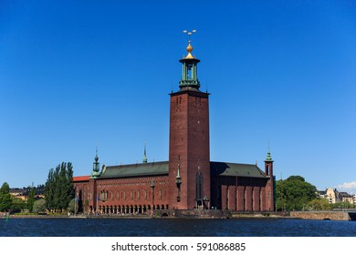 STOCKHOLM, SWEDEN - JUNE 04, 2015. Stockholm City Hall, or Stockholms stadshus, the building of the Municipal Council for the City of Stockholm ,seen from the south, across Riddarfjärden on a summer