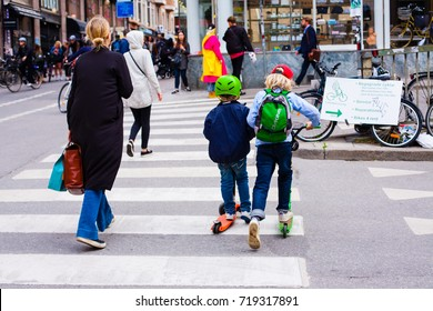 Stockholm, Sweden - June 09, 2017 : Funny children skate on the scooters at the crossroads. ferrying