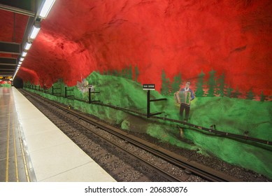 STOCKHOLM, SWEDEN - JUNE 10, 2014: Solna Centrum metro station on June 10, 2014 in Stockholm, Sweden. This station was painted in 1975 by artists Anders Aberg and Karl-Olov Bjork.