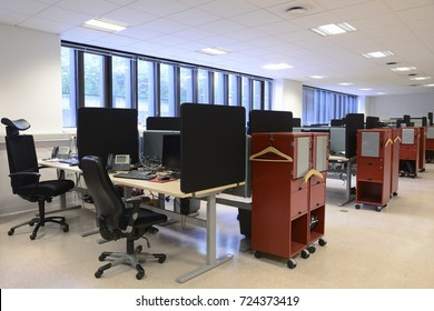 Stockholm, Sweden - June 10, 2017: Office Desks And Chairs in a row.