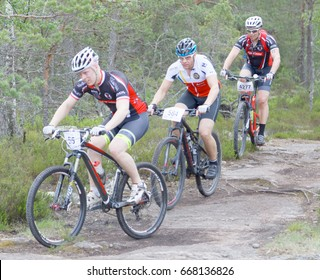 STOCKHOLM, SWEDEN - JUNE 11, 2017: Group of mountain bike cyclists in the forest at Lida Loop Mountain bike Race. June 11, 2017 in Stockholm, Sweden