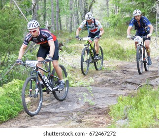 STOCKHOLM, SWEDEN - JUNE 11, 2017: Group of male mountain bike cyclists in the forest at Lida Loop Mountain bike Race. June 11, 2017 in Stockholm, Sweden