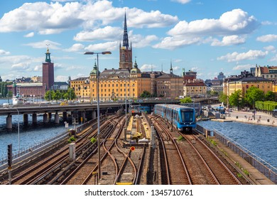 Stockholm, Sweden - June 2016: Railway tracks and trains near Stockholm's main train station in Norrmalm area, Stockholm, Sweden. Subway train coming from Gamla Stan, Stockholm, Sweden