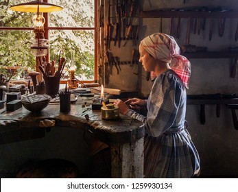 Stockholm, Sweden, June 22, 2018: A silversmith at the Skansen open air museum is working on her object in view of visitors from around the world.