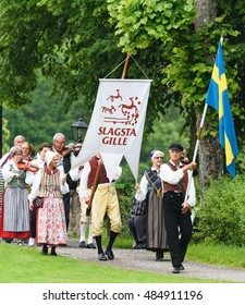 Stockholm, Sweden - June 24, 2016: Midsummer celebrations with Slagsta Gille in Hagelbyparken, botkyrka. Slagsta Gille consists of musicians and dancers who play old Swedish folk music.