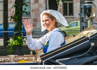 STOCKHOLM, SWEDEN - JUNE 6, 2016: Royal cortege with Princess Madeleine waving. Swedish Royalty on the way to Skansen.
