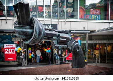 STOCKHOLM, SWEDEN - JUNE 7, 2014: Outdoor closeup of the famous Non Violence sculpture in shape of a Magnum handgun with a knot on the barrel on a shopping street in Stockholm Sweden June 7, 2014.