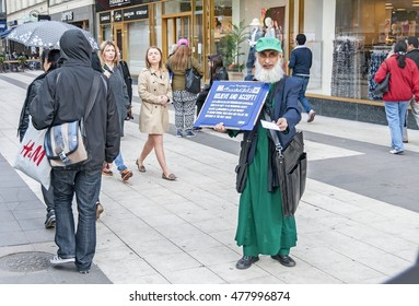 STOCKHOLM, SWEDEN. June 8, 2015. Muslim preacher collecting charity in the Drottninggatan (Queen's) street of Stockholm.