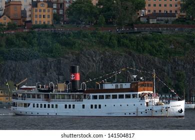 STOCKHOLM, Sweden - JUNE 8: Princess Madeleine and Chris O´Neill and friends on the steamboat Stockholm going from Riddarholmen to Drottningholm Castle. June 8, 2013, Stockholm, Sweden