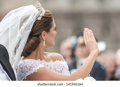 STOCKHOLM, Sweden - JUNE 8: Princess Madeleine waving to the crowd on the carriage to Riddarholmen after the wedding with Chris O´Neill in Slottskyrkan. June 8, 2013, Stockholm, Sweden