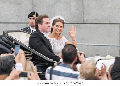 STOCKHOLM, SWEDEN - JUNE 8: Princess Madeleine and Chris O´Neill ride in a carriage on the way to Riddarholmen after their wedding in Slottskyrkan. June 8, 2013, Stockholm, Sweden