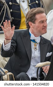 STOCKHOLM, Sweden - JUNE 8:Chris O´Neill waving his hand in a carriage on the way to Riddarholmen after the wedding with Princess Madeleine in Slottskyrkan. June 8, 2013, Stockholm, Sweden