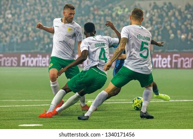 STOCKHOLM, SWEDEN - MAR 10, 2019: Odilon and Fallman (HIF) stopping a rival at the Swedish soccer cup quarter finals between Djurgarden vs Hammarby in a derby. March 10 2019,Stockholm,Sweden