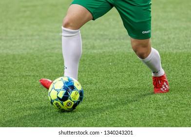 STOCKHOLM, SWEDEN - MAR 10, 2019: Closeup of dribbling player  at the Swedish soccer cup quarter finals between Djurgarden vs Hammarby. March 10 2019,Stockholm,Sweden