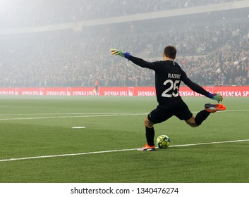 STOCKHOLM, SWEDEN - MAR 10, 2019: Keeper Davor Blazevic kicking the ball at the Swedish soccer cup quarter finals between Djurgarden vs Hammarby. March 10 2019,Stockholm,Sweden