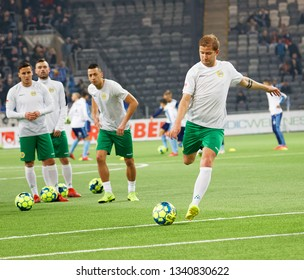 STOCKHOLM, SWEDEN - MAR 10, 2019: The Hammarby soccer team warming up at the derby at the Swedish soccer cup quarter finals between Djurgarden vs Hammarby. March 10 2019,Stockholm,Sweden