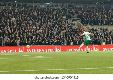 STOCKHOLM, SWEDEN - MAR 10, 2019: Muamer Tancvic shooting in the penalty shootout at the Swedish soccer cup quarter finals between Djurgarden vs Hammarby. March 10 2019,Stockholm,Sweden