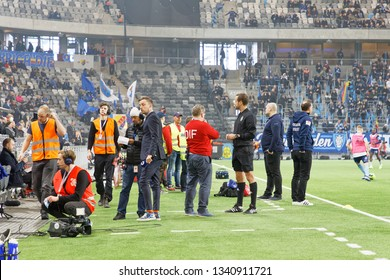 STOCKHOLM, SWEDEN - MAR 10, 2019: Media, guards, judge  and press at the Swedish soccer cup quarter finals between Djurgarden vs Hammarby. March 10 2019,Stockholm,Sweden