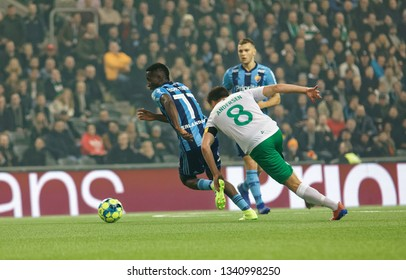 STOCKHOLM, SWEDEN - MAR 10, 2019: Duel between Mohamed Buya Turayand and Jeppe Andersen at the Swedish soccer cup quarter finals between Djurgarden vs Hammarby. March 10 2019,Stockholm,Sweden