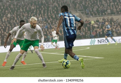 STOCKHOLM, SWEDEN - MAR 10, 2019: Duel between Mohamed Buya Turay and and competitors  at the Swedish soccer cup quarter finals between Djurgarden vs Hammarby. March 10 2019,Stockholm,Sweden