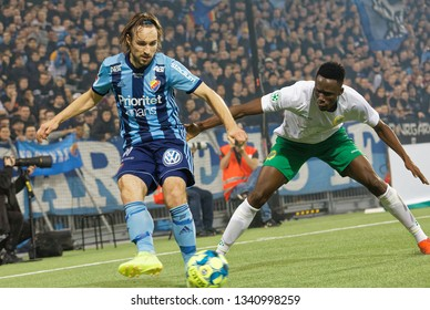 STOCKHOLM, SWEDEN - MAR 10, 2019: Duel between Kevin Walker and Kouakou Odilion at the Swedish soccer cup quarter finals between Djurgarden vs Hammarby. March 10 2019,Stockholm,Sweden